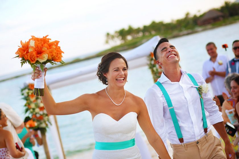 just married happy emotional bride and groom exit beach destination wedding ceremony Grand Sirenis Riviera Maya Mexico
