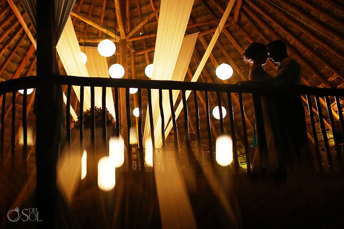 dramitic night time portrait destination wedding palapa Grand Sirenis Riviera Maya Mexico