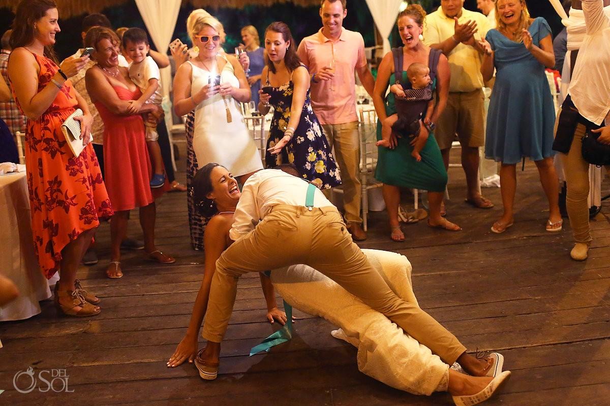 funny wedding photo choreographed first dance dip gone wrong destination wedding reception Grand Sirenis Riviera Maya Mexico
