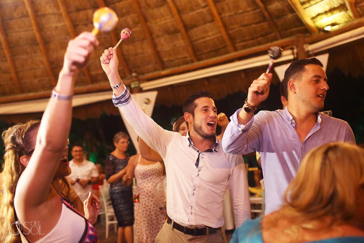shaking maracas destination wedding reception Grand Sirenis Riviera Maya Mexico