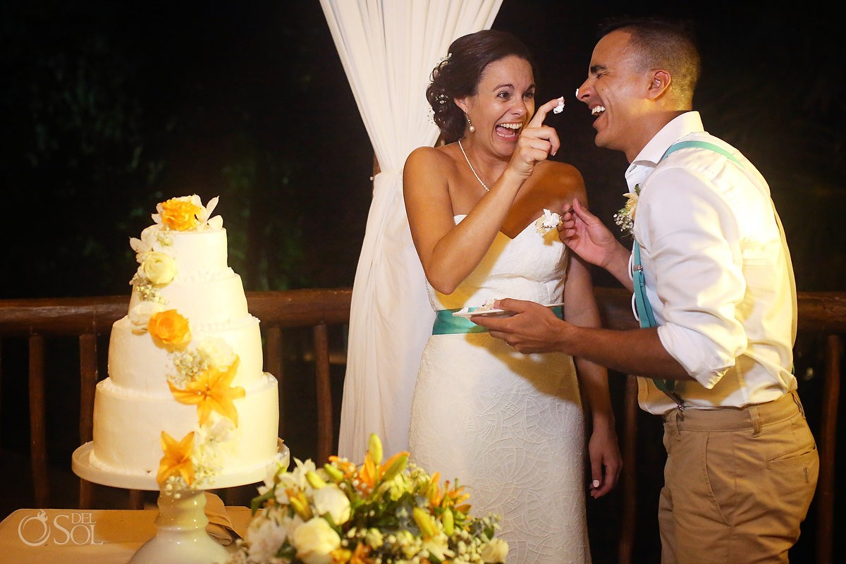 cute cake cutting photo destination wedding reception Grand Sirenis Riviera Maya Mexico