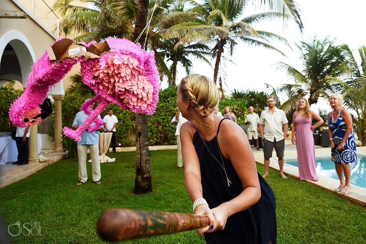 guest hitting piñata wedding reception ideas Hacienda del Mar Riviera Maya Mexico
