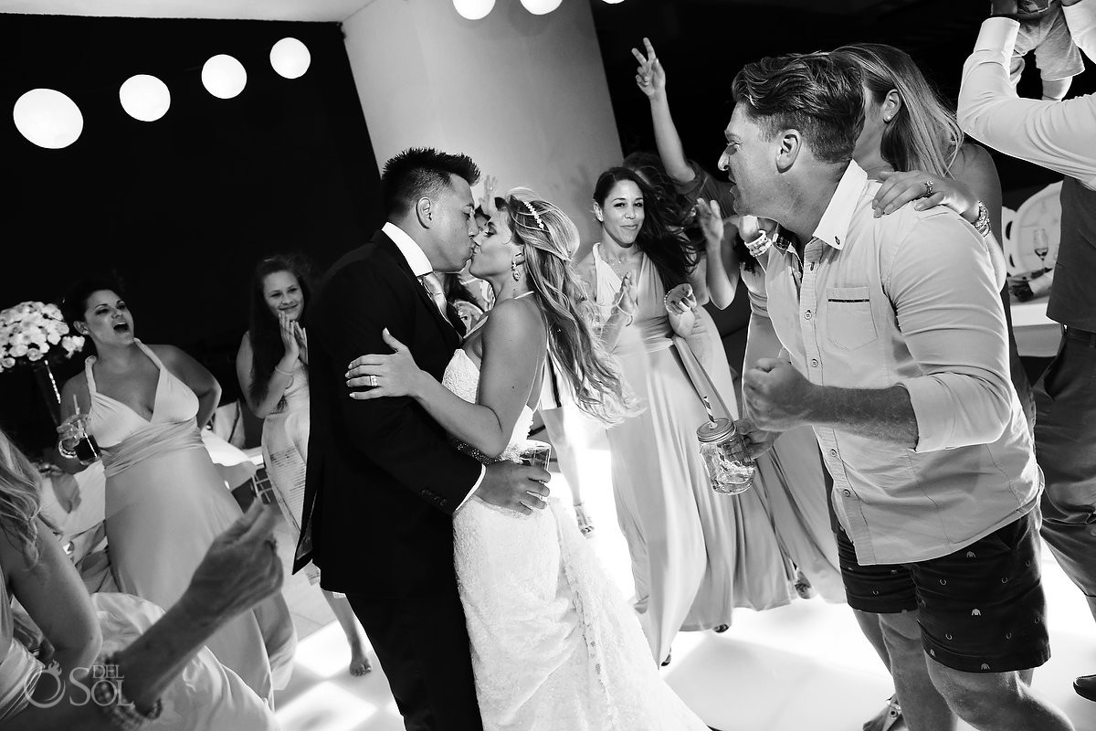 bride and groom kiss black and white photo Destination wedding reception Hyatt Ziva Cancun Sky Terrace