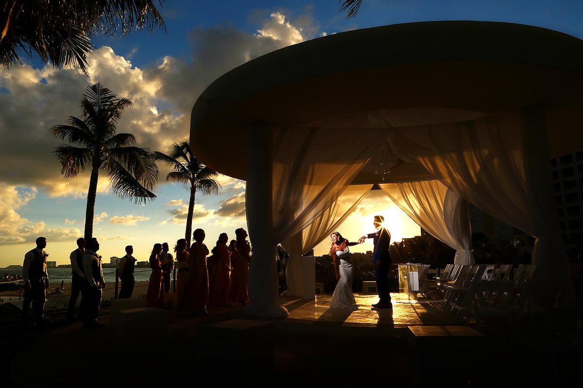 sunset bridal party bride dancing portrait Destination Wedding Hyatt Ziva Cliff Gazebo