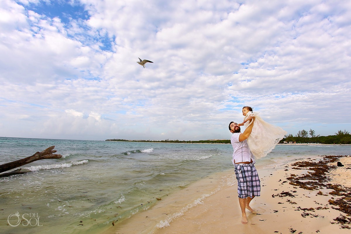 Father throws baby bird flying beach trash the dress Playa del Carmen