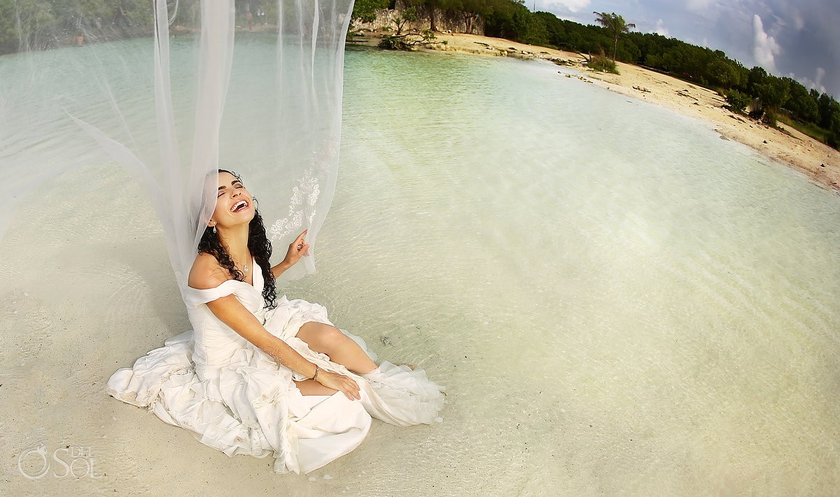 bride laughing veil flying beach trash the dress Playa del Carmen Mexico