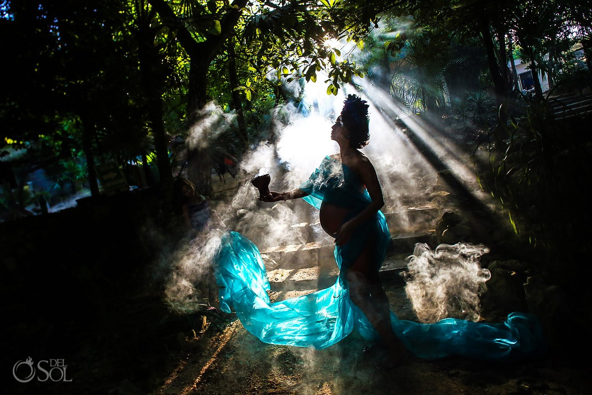 stunning maternity photo silhouette pregnant mother in rays of light and smoke dressed as ether the life force
