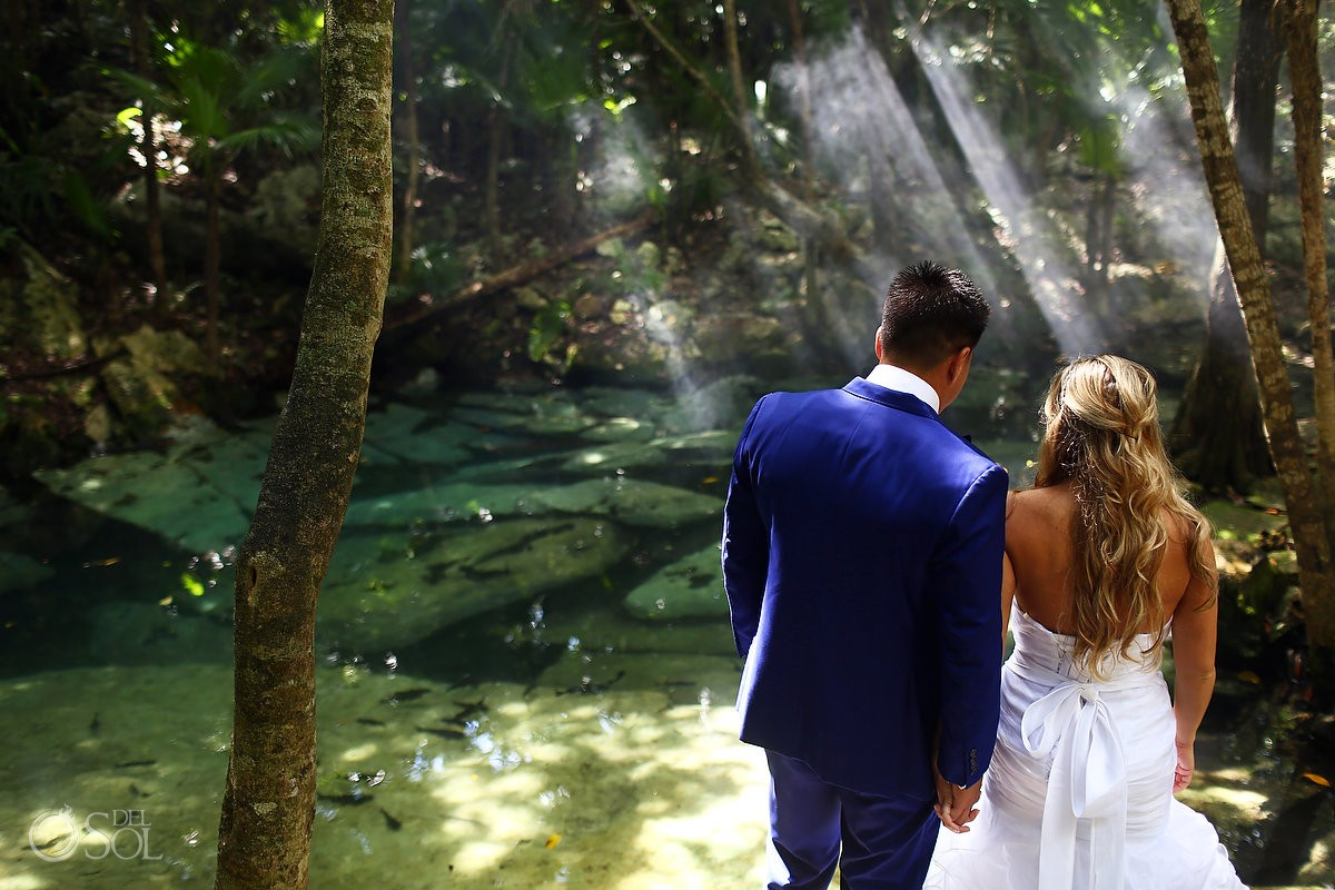 Bride and groom watching jungle nature, Cenote trash the dress Riviera Maya, Mexico