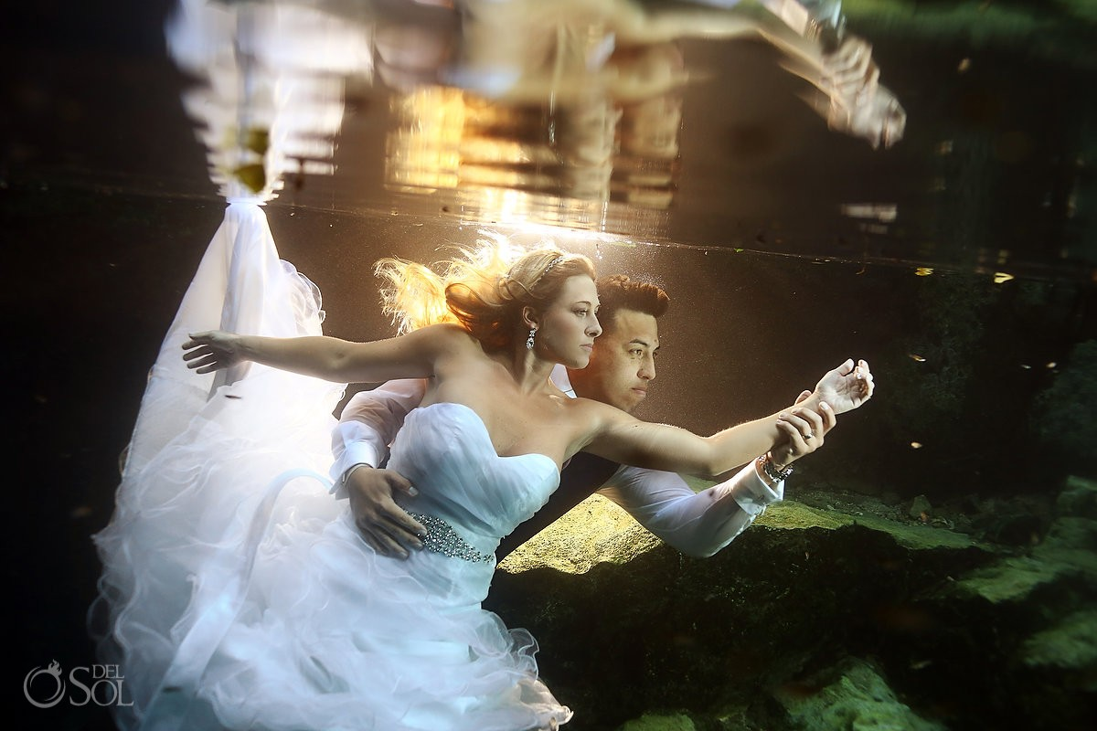 Dancing underwater bride and groom Cenote trash the Dress Riviera Maya, Mexico