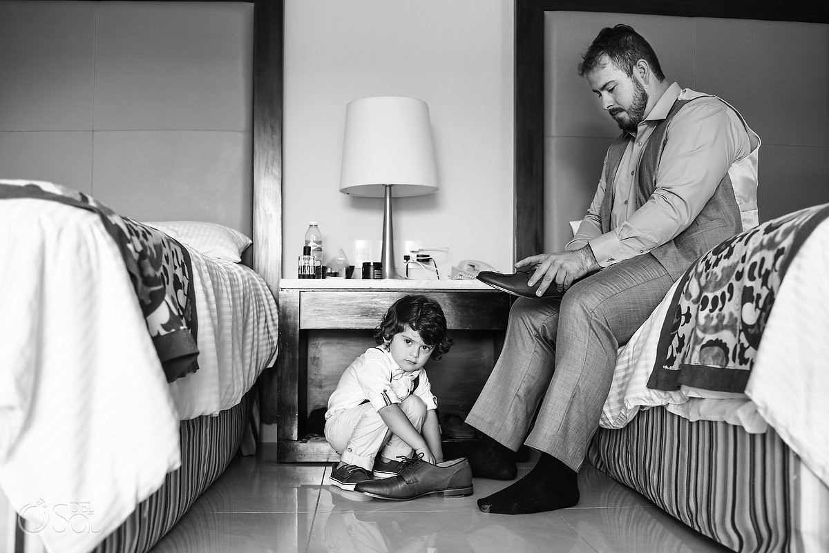 groom getting ready with son black and white photo destination wedding Now Jade Puerto Morelos Mexico