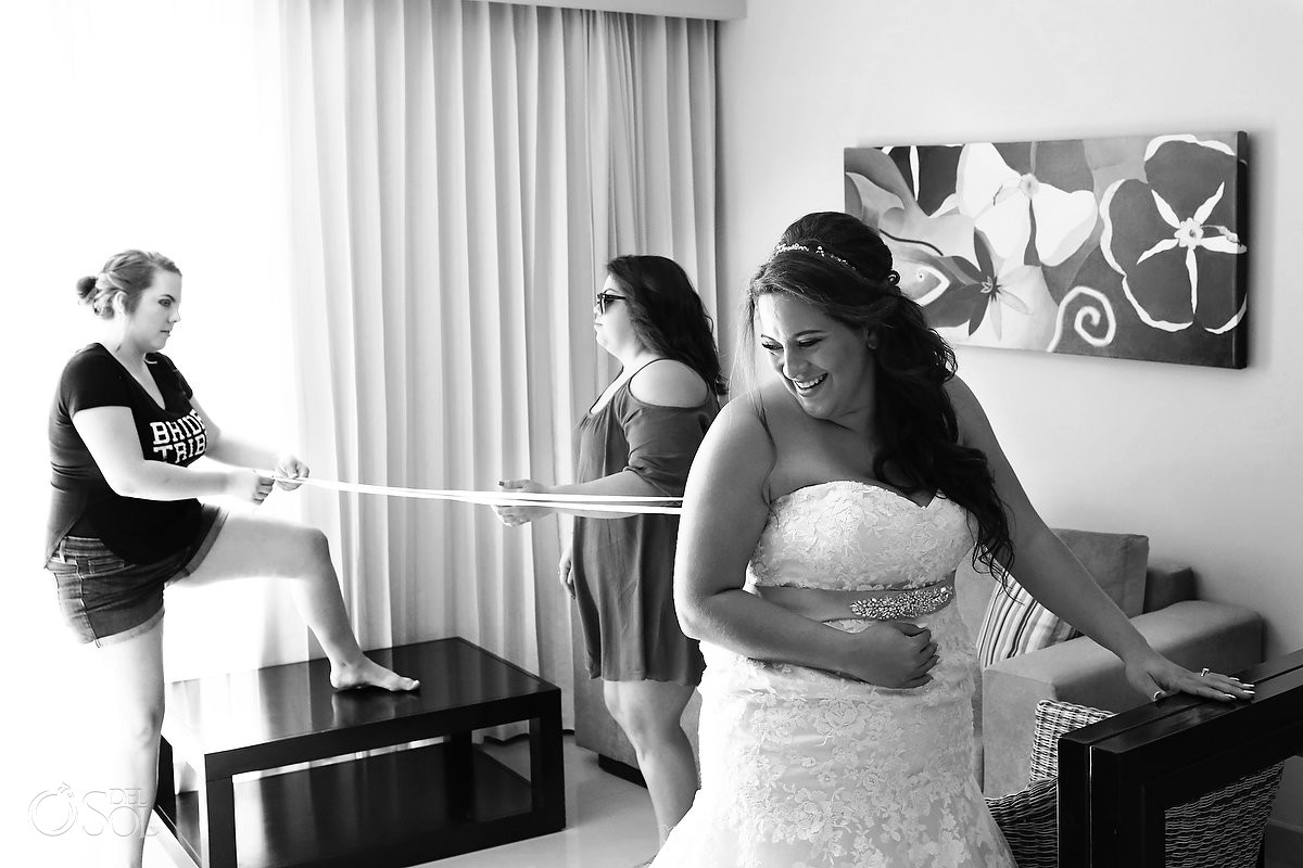 bride getting ready putting dress on destination wedding Now Jade Puerto Morelos Mexico