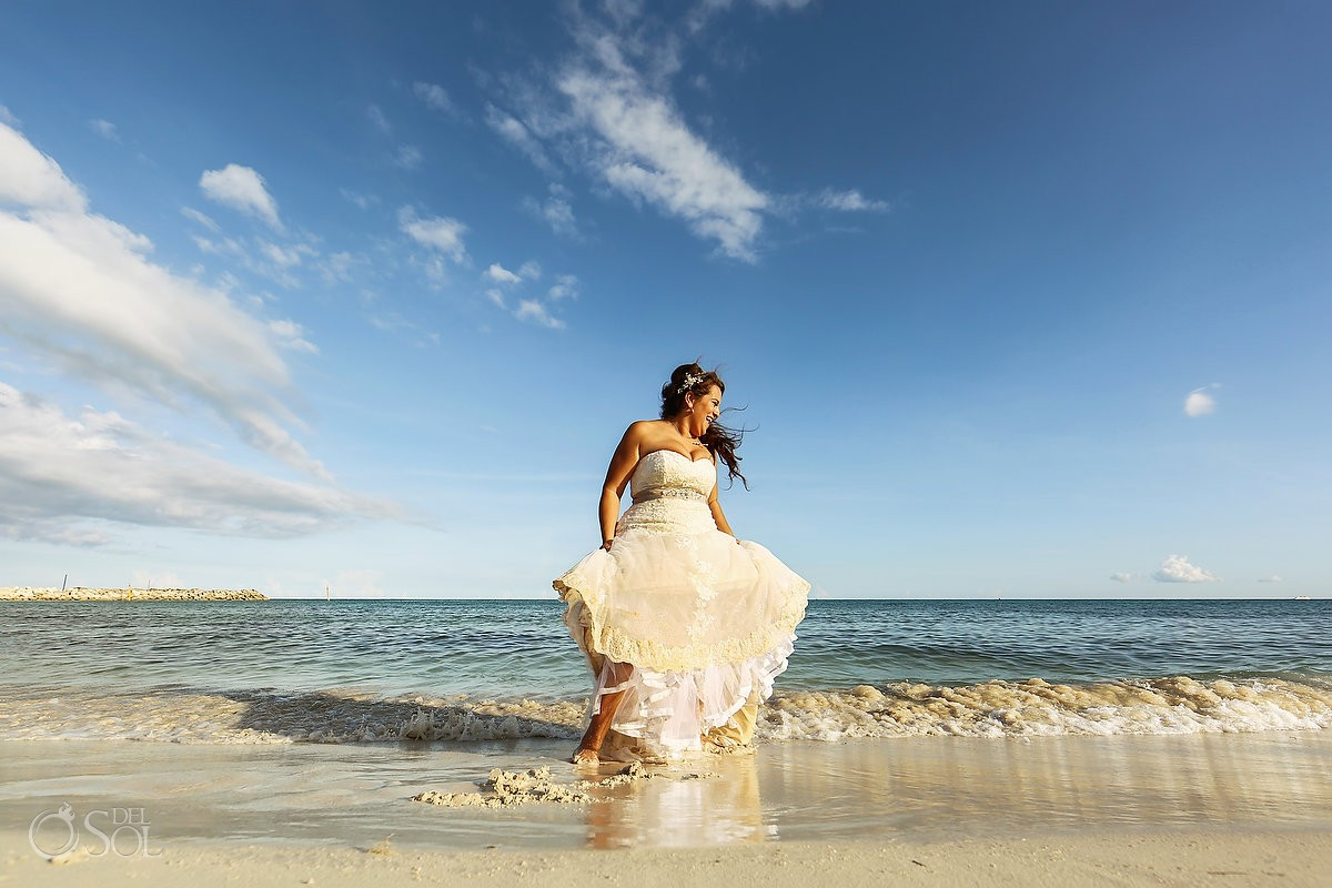 bride portrait playing in the waves destination wedding Now Jade Puerto Morelos Mexico