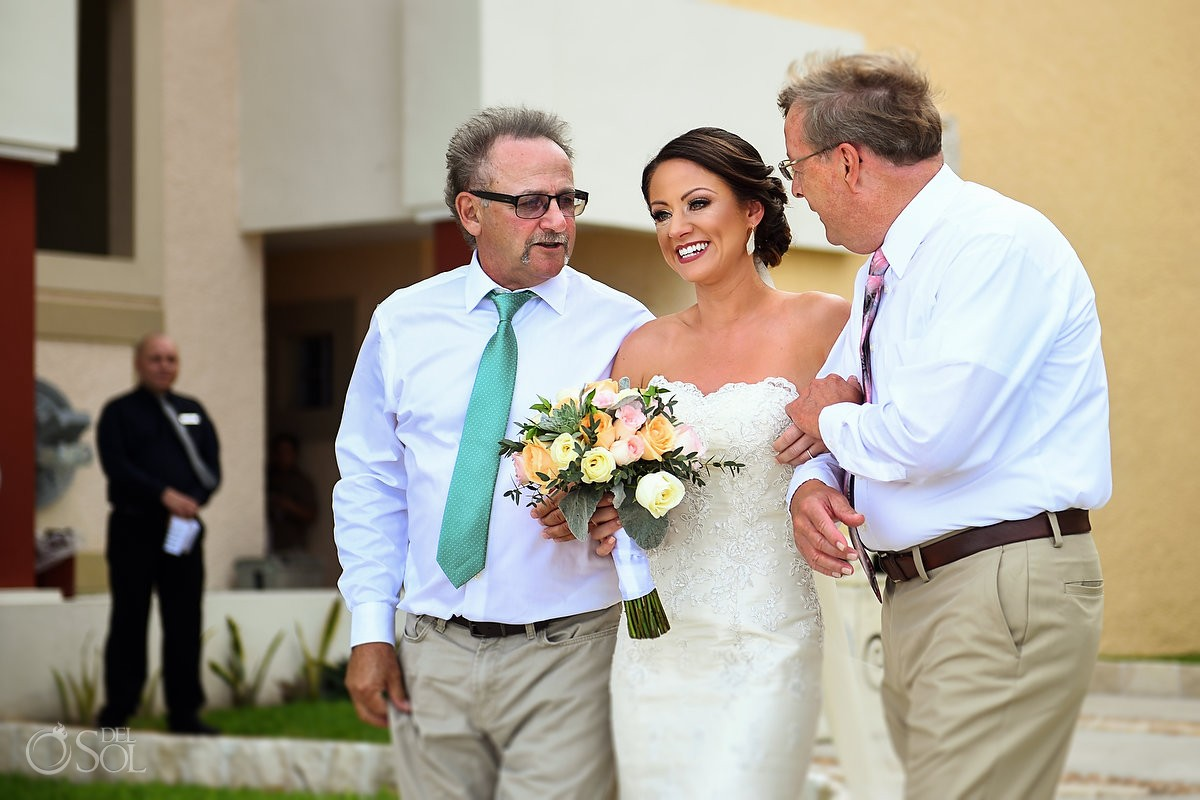 including step-parents in your wedding day bride walks down aisle with father and stepfather Now Sapphire Beach wedding