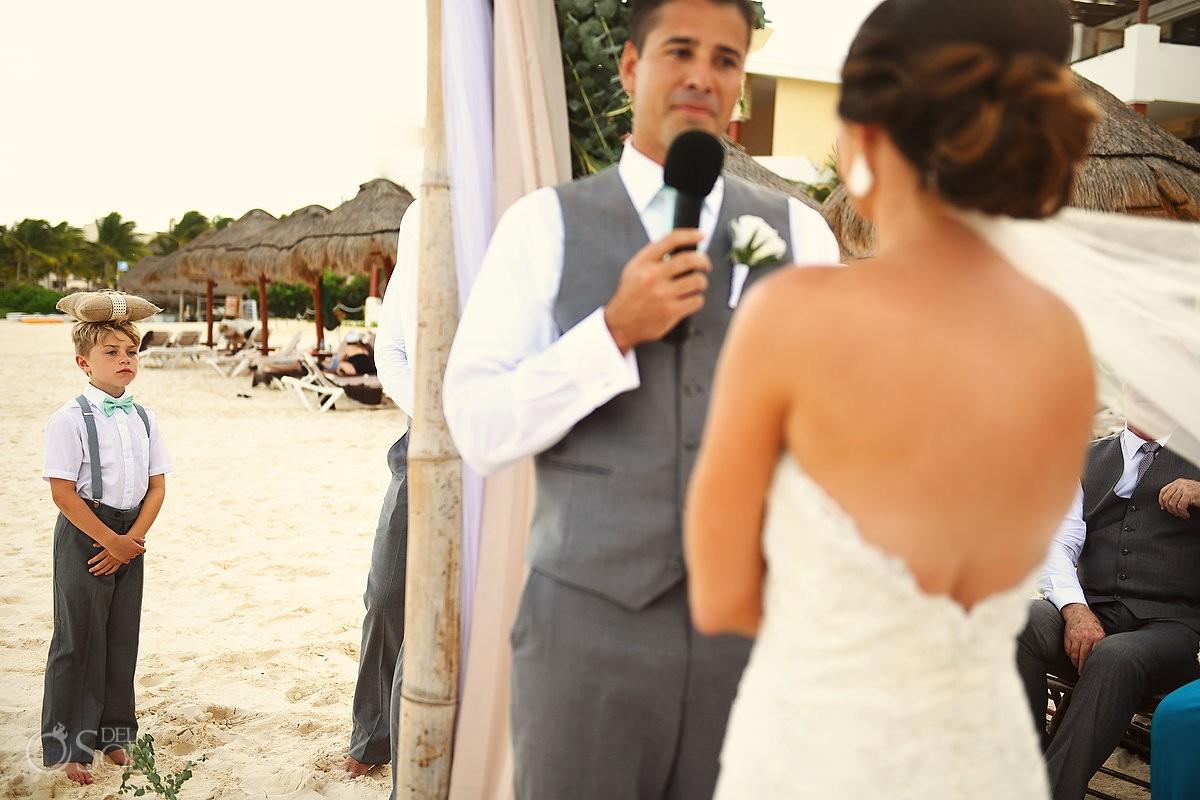 funny wedding photo cute kid ring bearer balancing ring cushion on his head destination wedding Now Sapphire beach Mexico