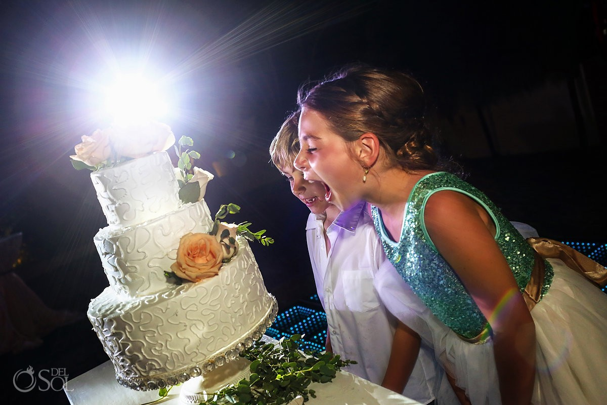 funny wedding pictures flower girl cute kids trying to eat wedding cake reception poolside Now Sapphire Mexico