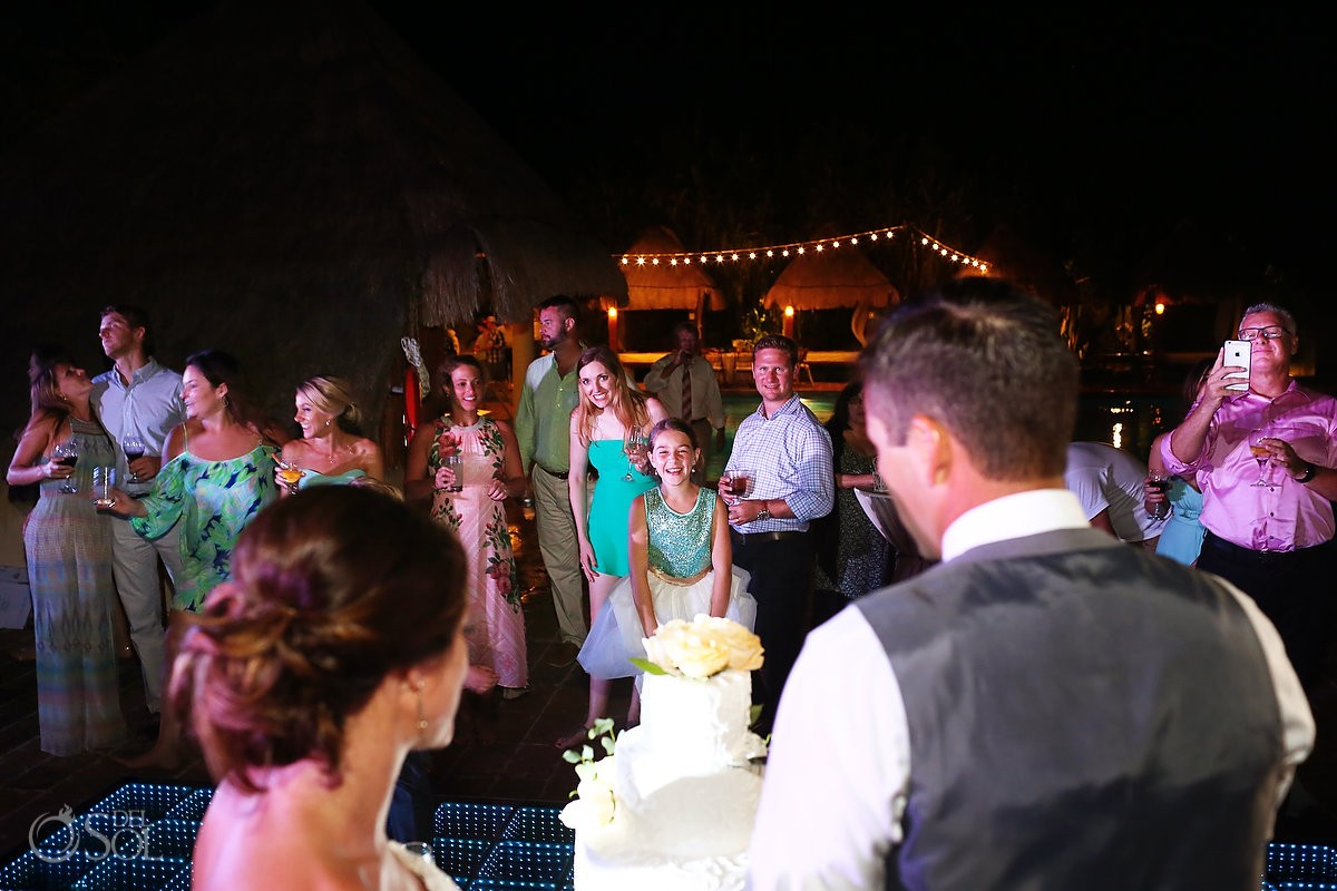 cake cutting destination wedding reception poolside Now Sapphire Mexico