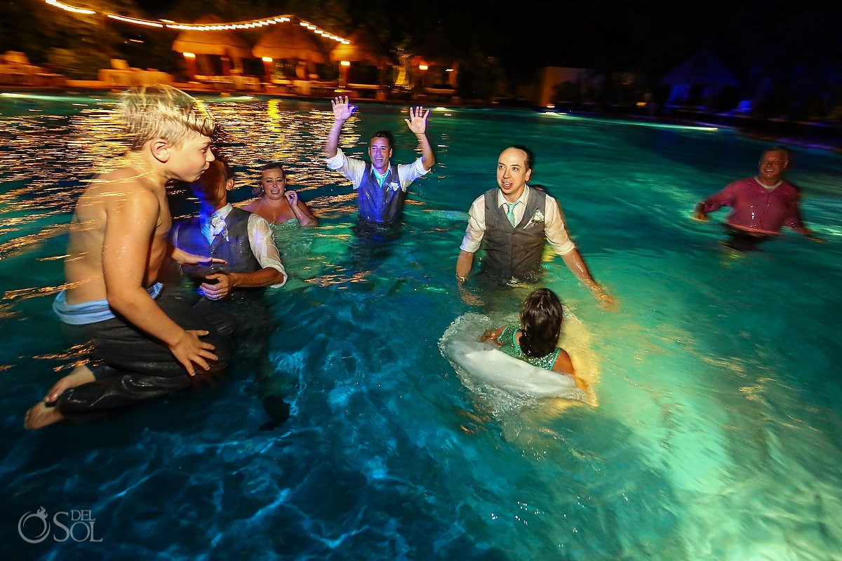 funny wedding photo groom best man groomsman jumping in swimming pool Now Sapphire destination wedding reception Mexico