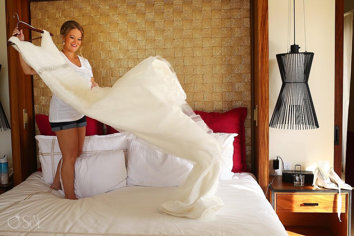 bride taking her Mori Lee Wedding dress Riviera Maya destination wedding Secrets Akumal Mexico
