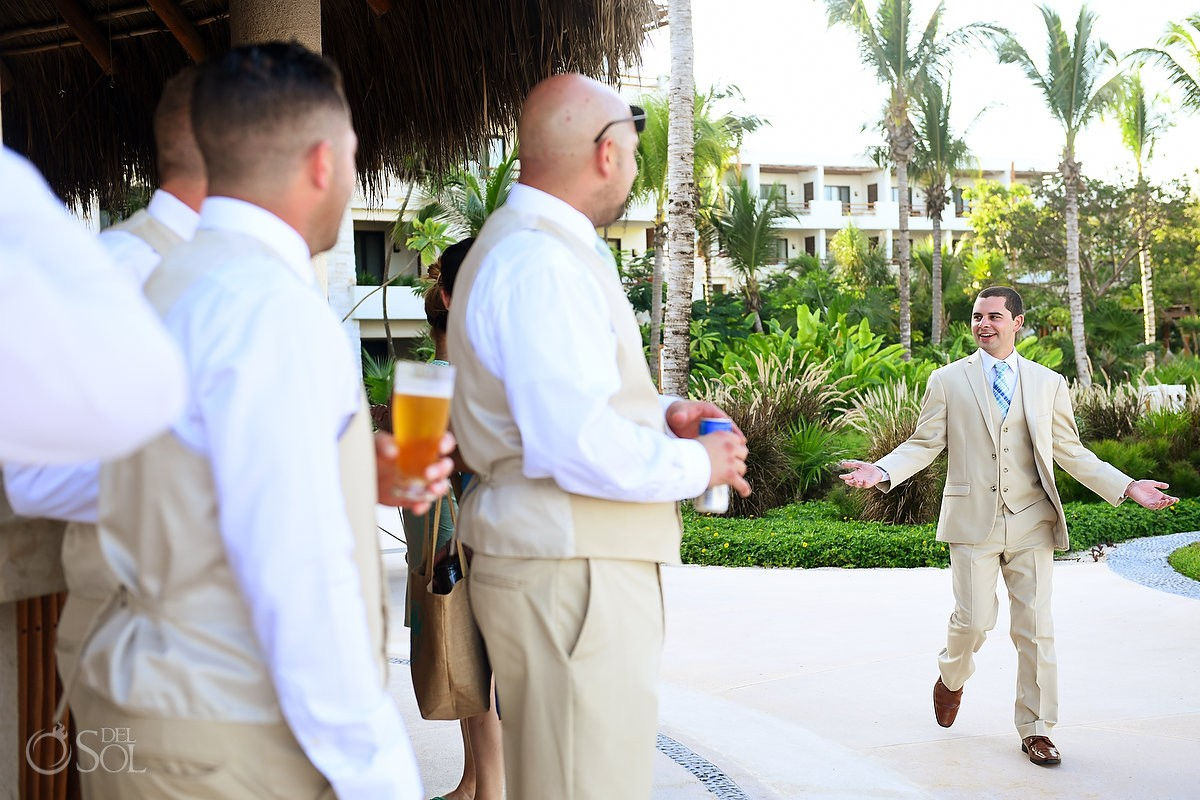 groom hanging out at the bar with friends getting ready Riviera Maya destination wedding Secrets Akumal Mexico