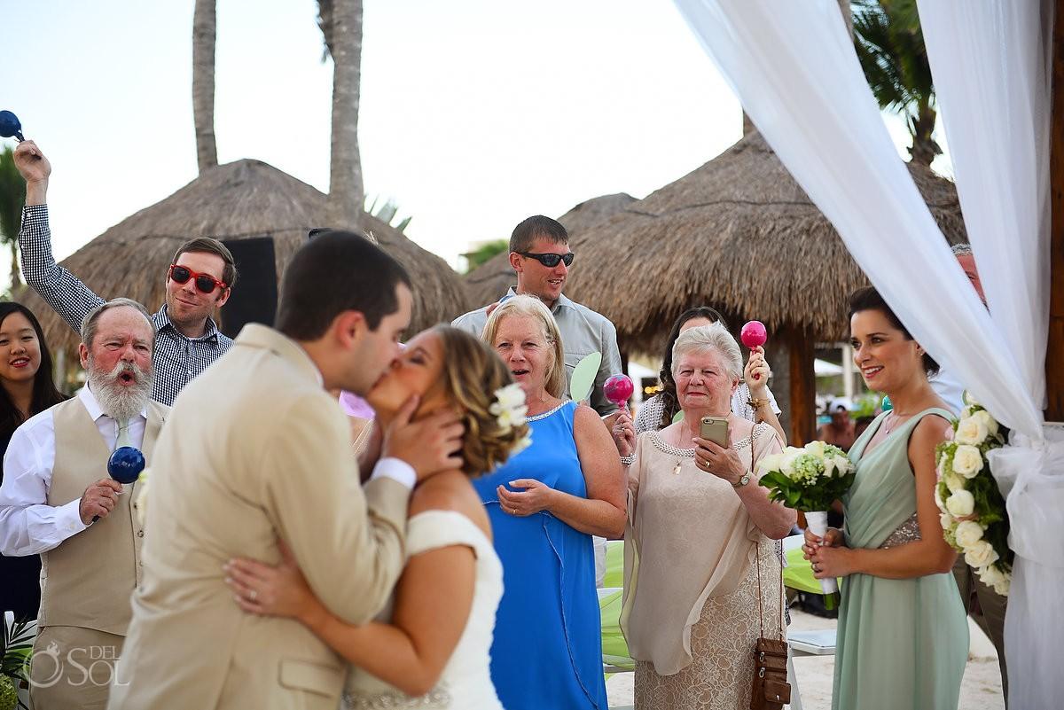 guest reactions shaking maracas first kiss beach ceremony Riviera Maya destination wedding Secrets Akumal Mexico