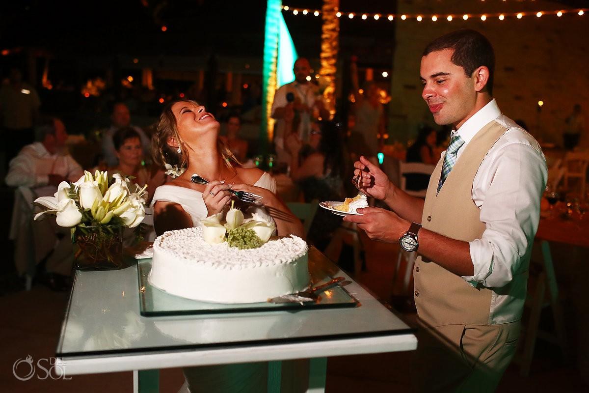 funny cake cutting picture Riviera Maya Destination Wedding reception Secrets Akumal