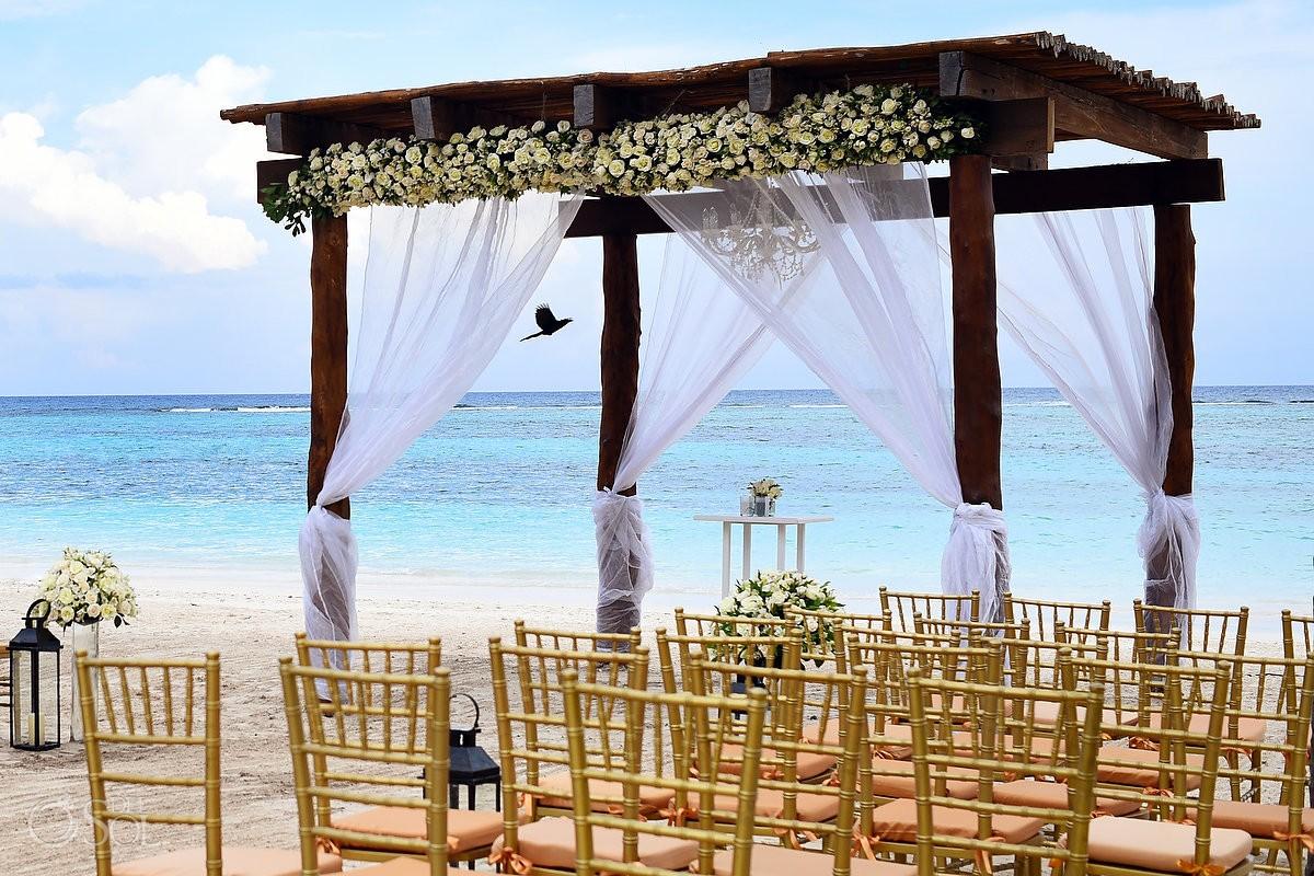 Beach gazebo wedding bird flying Secrets Akumal Riviera Maya Mexico