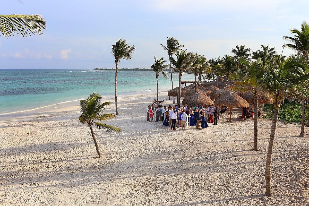 Destination wedding beach location cocktail hour Secrets Akumal Riviera Maya Mexico