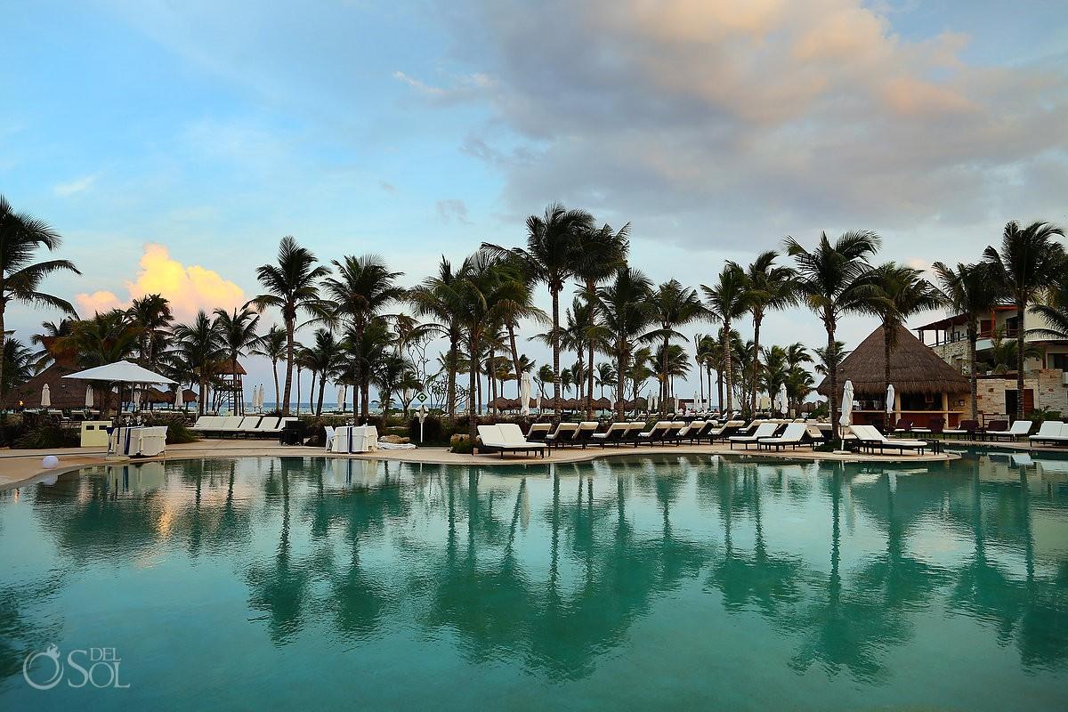 Beach palm tree pool reflection destination weddings Secrets Akumal Riviera Maya Mexico