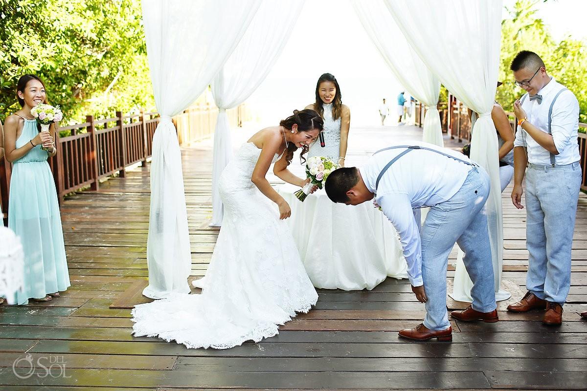 funny wedding photos bride laughing because she dropped the wedding ring Gabi bridge Paradisus Playa del Carmen Mexico