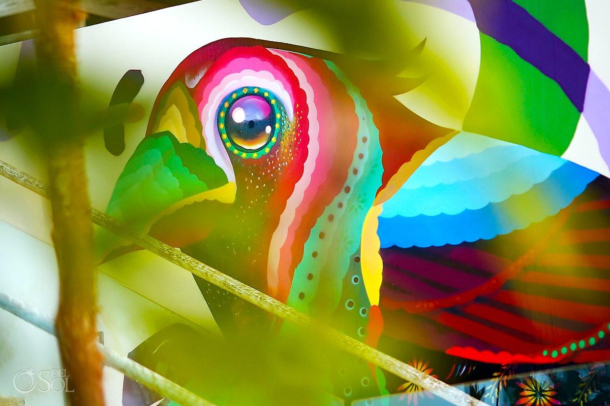 Yucatan Cardinal bird mural by Riviera Maya graffiti artist Senkoe Andaz Mayakoba Playa del Carmen Mexico