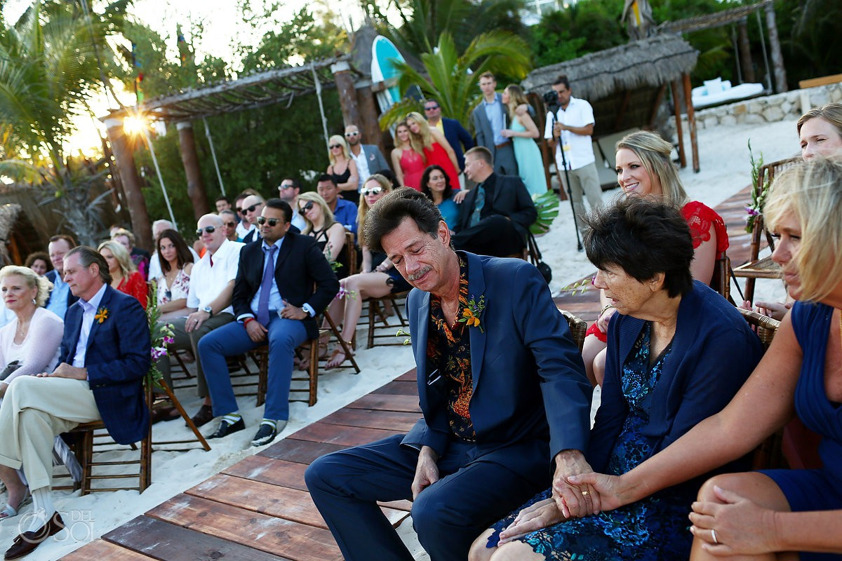 emotional ceremony moment guests holding hands Playa del Carmen Boutique Wedding Viceroy Riviera Maya