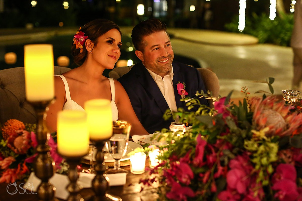 bride and groom listening to speeches poolside destination wedding reception Playa del Carmen Boutique hotel Viceroy Riviera Maya