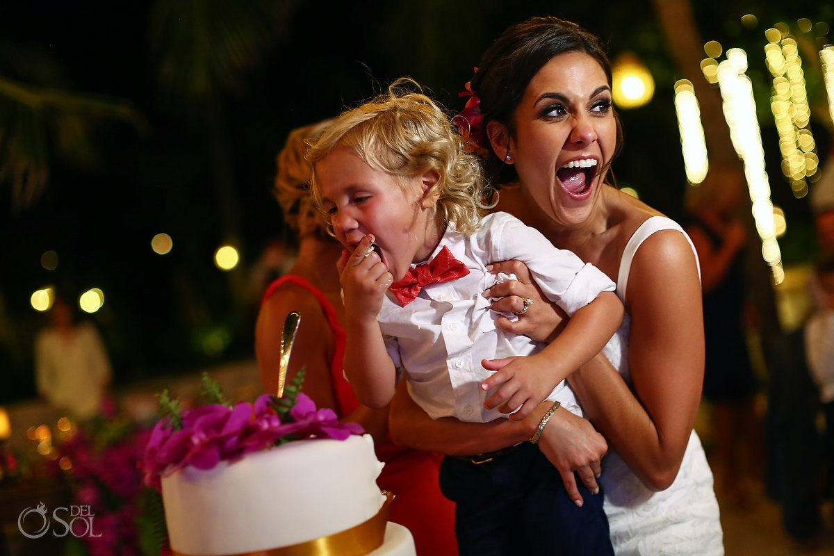 cute ring bearer eating cake poolside destination wedding reception Playa del Carmen Boutique hotel Viceroy Riviera Maya
