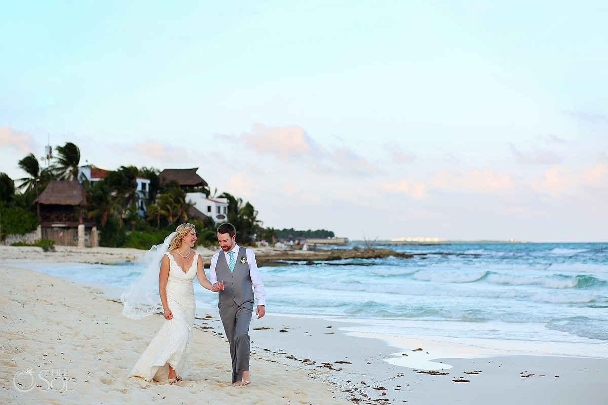 bride and groom walking at the beach Destination wedding Hacienda del Secreto Riviera Maya Playa del Secreto Mexico