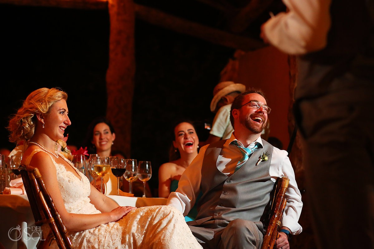 Bride and groom couple enjoying speeches friends Destination Wedding Hacienda del Secreto Riviera Maya