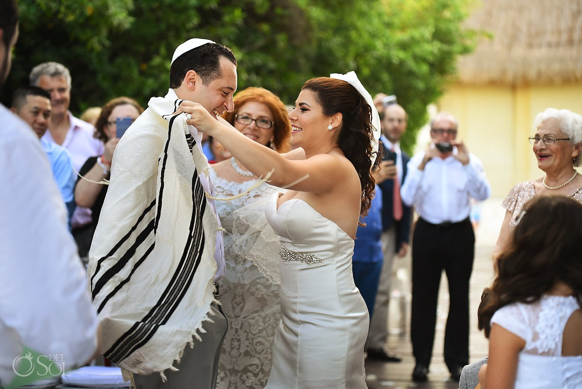 Playa del Carmen Jewish Wedding tradition bride putting Tallit prayer shawl on grooms shoulders Paradisus Riviera Maya Gabi Bridge