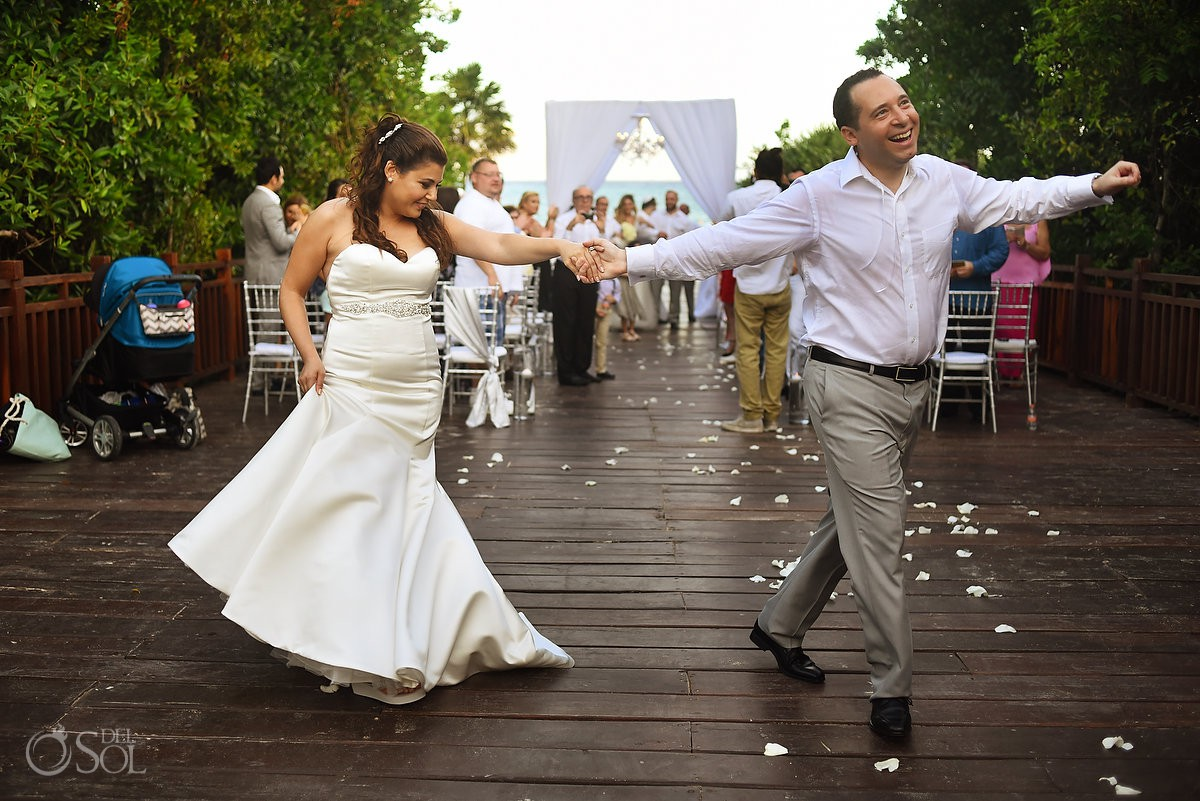 funny wedding photo happy groom dancing ceremony exit Playa del Carmen Jewish Wedding Paradisus Riviera Maya Gabi Bridge