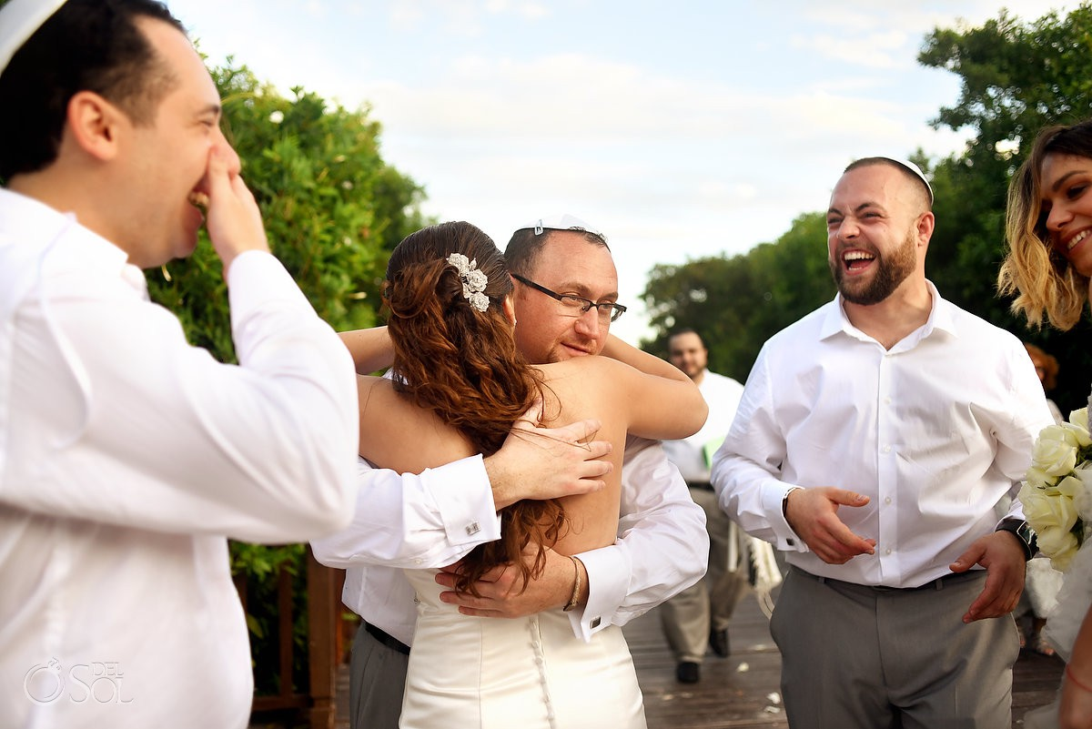 After ceremony hugs celebration Playa del Carmen Jewish Wedding Paradisus Riviera Maya Gabi Bridge