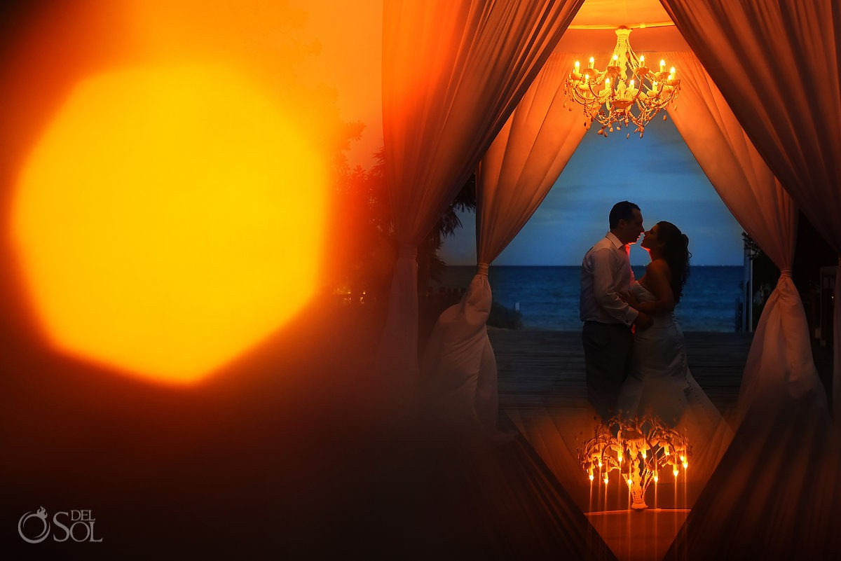 artistic wedding portrait silhouette under chuppah chandelier Playa del Carmen Paradisus Gabi Bridge