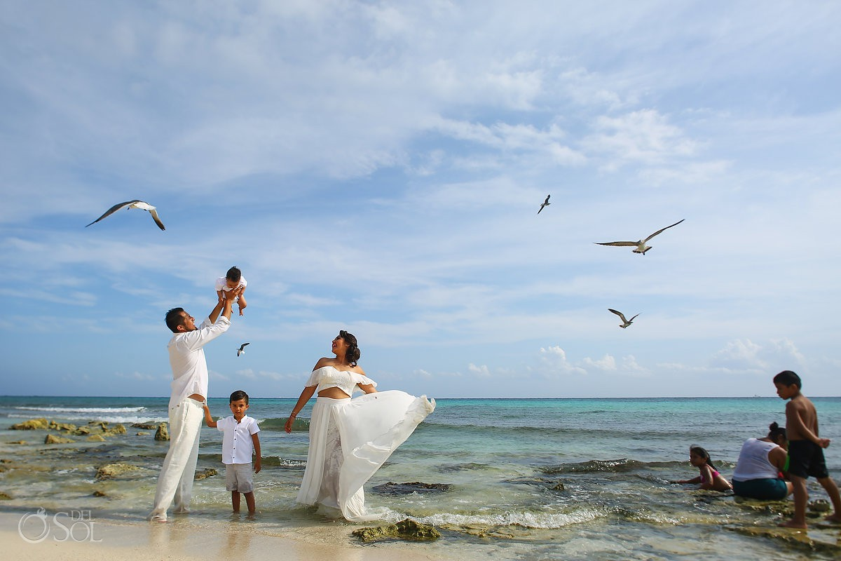 Beach trash the dress family portraits Playa del Carmen México.