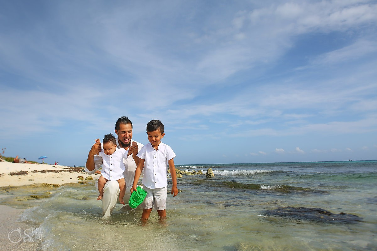 Beach family portraits father and sons trash the dress Playa del Carmen México.