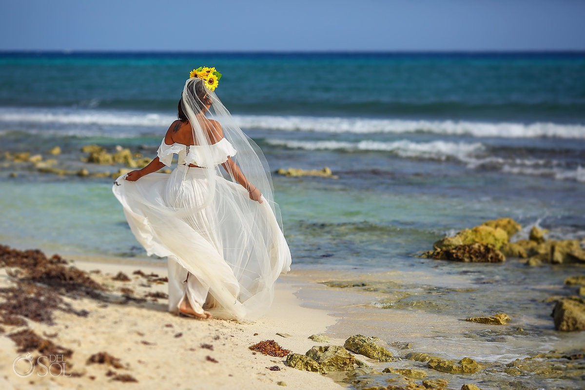 bride with beautiful wedding dress beach trash the dress Playa del Carmen México.