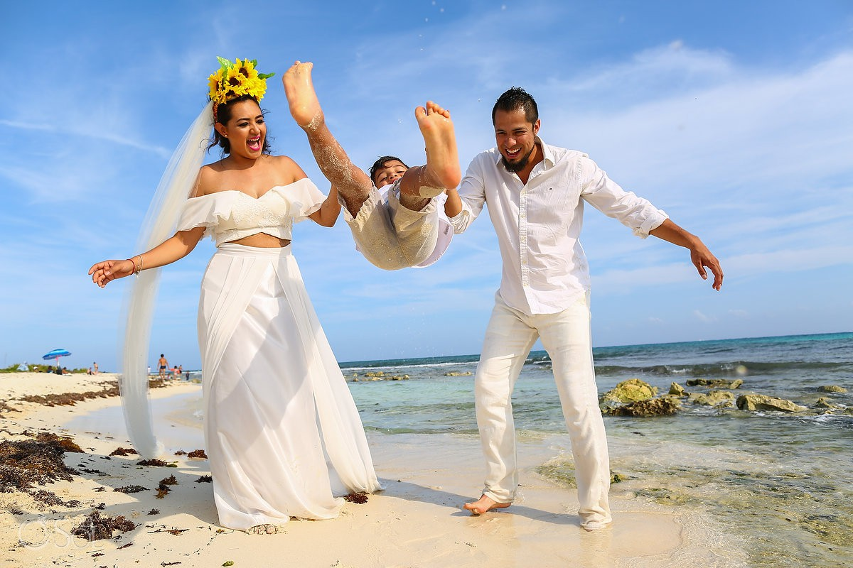 Family love bride and groom with son beach trash the dress Playa del Carmen México.