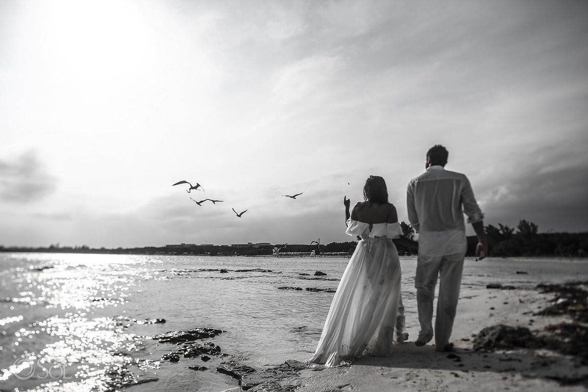 bride and groom walking beach trash the dress Playa del Carmen México.