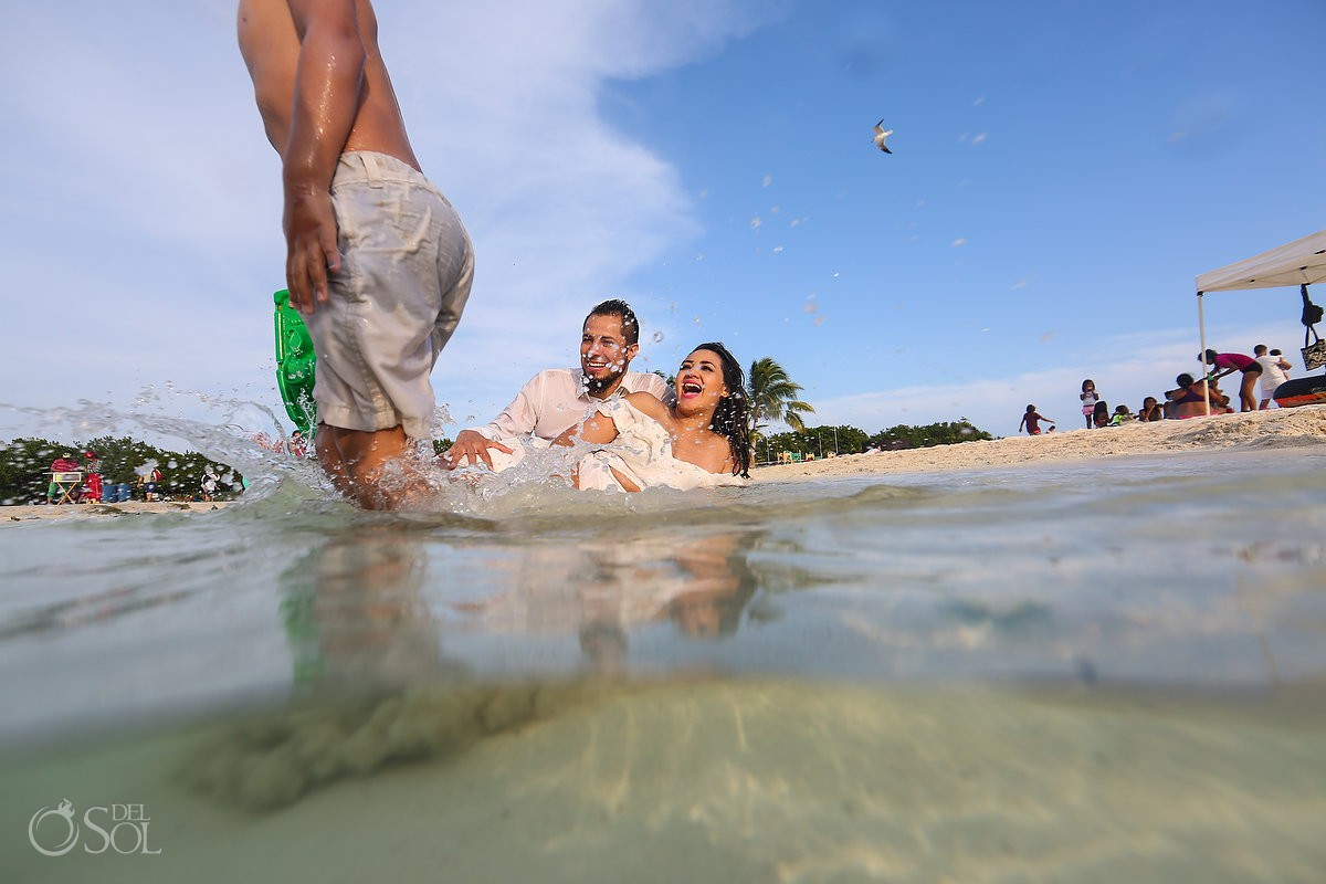 Bride,groom and son beach trash the dress Playa del Carmen México.