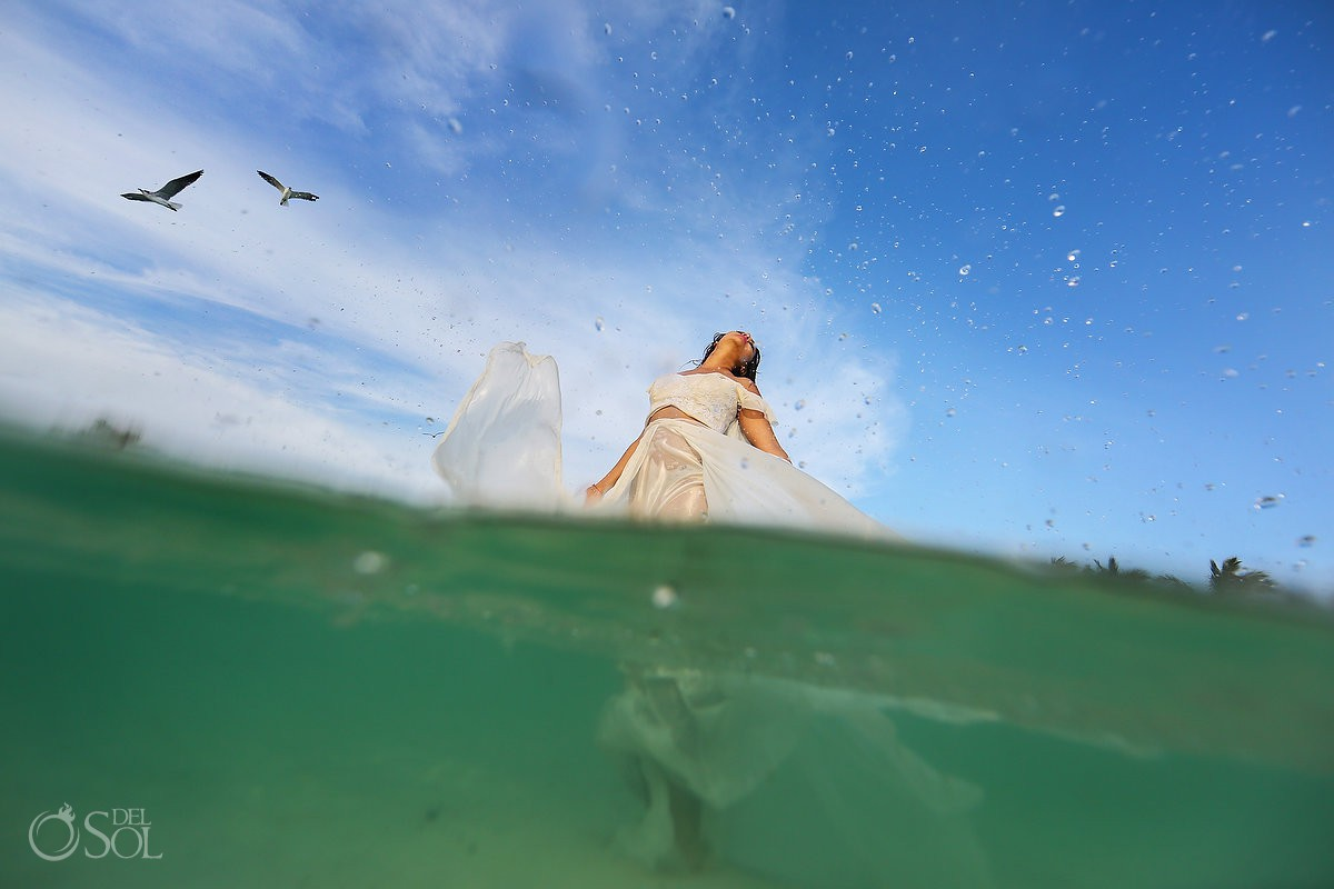 Bride enjoying life beach trash the dress Playa del Carmen México.
