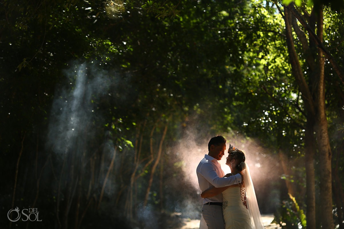 Beautiful bride and groom portrait in jungle Cenote Trash the Dress Riviera Maya Mexico.