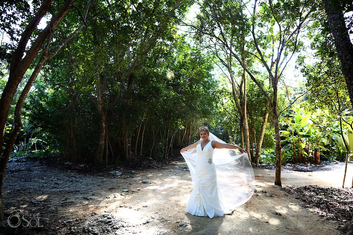 Bride enjoying nature and light Cenote Trash the Dress Riviera Maya Mexico.