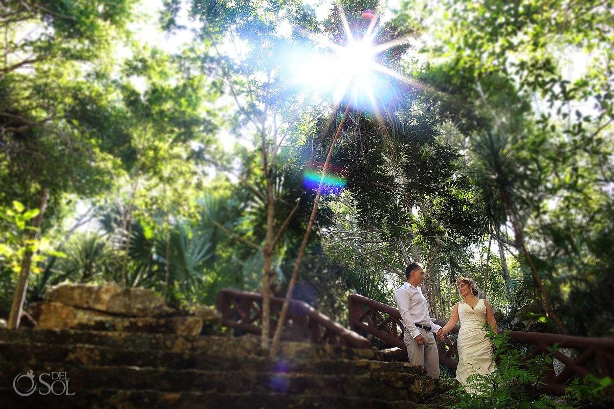Amazing sun light in jungle bride and groom Cenote Trash the Dress Riviera Maya Mexico.