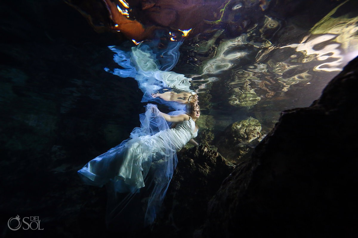 Beautiful underwater bride reflection portrait Trash the Dress Riviera Maya Mexico.